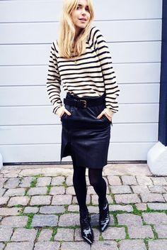 Striped sweater tucked into belted leather skirt and tights.
