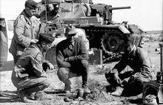 Panzer III & staff car in North Africa.