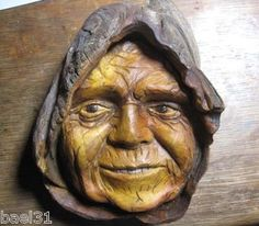 My newest carved wood spirit, a wrinkled old woman wearing a hood.  Carved from Mississippi River driftwood, this old witch actually appears to be friendly!  Ready to hang on your wall and priced to sell, listed on ebay.