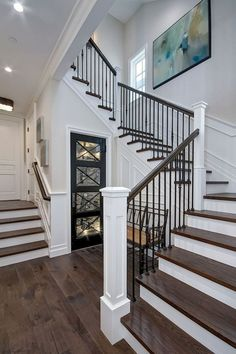 The staircase features White Oak wood treads and custom wrought iron spindles. The staircase features White Oak wood treads and custom wrought iron spindles. Wrought Iron Staircase, Staircase Railings, Banisters, Staircase Ideas, Iron Spindle Staircase, Iron Railings, Open Staircase, Metal Spindles Staircase, Foyer Decorating