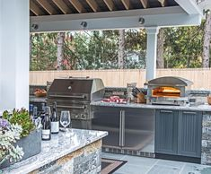 Double refrigerators and a pizza over ensure that this outdoor kitchen will be used frequently. Don't forget to add stainless steel cabinets by Danver to your design to store all the essentials and prevent unnecessary trips indoors!