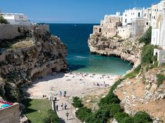 The stunning town of Polignano a Mare rises out of a cliff face on the Adriatic Sea. In addition to breathtaking views over the Adriatic, the tiny town also boasts charming, white-washed streets, enchanting old churches, and a beach with warm turquoise waters, flanked on either side by cliffs.