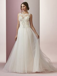 - AMANDA, Beaded lace motifs and Swarovski crystals cascade over the bodice of this elegant A-line wedding dress, accenting the illusion jewel over sweetheart neckline and illusion back. A voluminous tulle skirt completes this romantic look. Finished with covered buttons and zipper closure.
