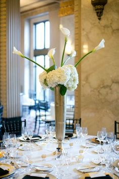 Flowers by Sisters Floral Design Studio www.sistersflowers.net  Photo by Heather Roth Photography-- Gold centerpieces, white and ivory flowers, hydrangea, white calla lilies, Peabody Opera House wedding