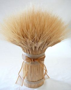 Wheat Centerpiece Ideas For A Country Wedding from rusticweddingchic.com