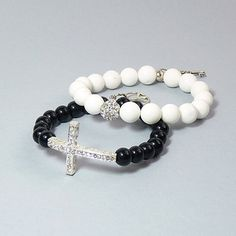 @Overstock.com - These handcrafted bracelets from Pretty Little Style feature white jade stones, black glass stones, rhinestones, and a silverplated cross. The rhinestone and decorative charms enhance the contrast between the two bracelets. http://www.overstock.com/Main-Street-Revolution/Pretty-Little-Style-Silverplated-Jade-Stretch-Bracelets-Night-and-Day/7110125/product.html?CID=214117 $28.99