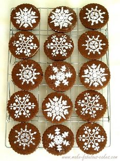 You can also use a stencil and powdered sugar to make snowflakes on any dark cookie. | 30 Adorable Treats To Make When It Snows