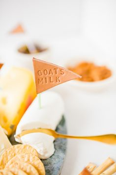 These handmade leather cheese labels are AMAZING and so easy. You can get letter stamps at Harbor Freight for cheap, and leather scraps at Michaels or online. Stamp, stamp, stamp, and done.  A great idea for cool DIY food labels for a party or wedding-- not just for cheese!