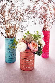 Add a stylish metallic touch to your day using glass vases, spray paint and sprigs of gypsophila! As seen on BridesMagazine.co.uk (BridesMagazine.co.uk)
