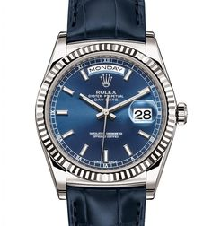 Rolex Day-Date 36 mm in white gold, fluted bezel, blue dial and leather strap.