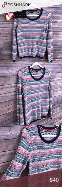 "Tommy Hilfiger red white blue striped sweater Tommy Hilfiger red white blue striped sweater. Very cute!! Excellent condition. Size L.  20"" arm pit to arm pit.  25"" length. Tommy Hilfiger Sweaters Crew & Scoop Necks"