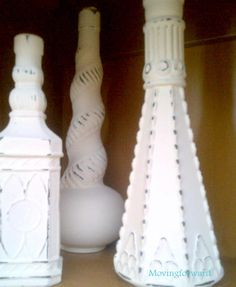 Painted Glass Bottles & Vases - simple: cover with several coats of milk paint, then lightly sand.