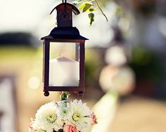 Line your aisles with lanterns hung on shepherd hooks- a wonderful touch at a garden wedding.