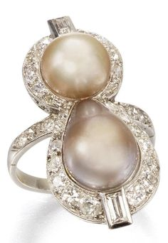 An Art Deco natural pearl and diamond ring, circa 1930. The drop and spherical-shaped pearls within a surround of millegrain-set old brilliant-cut diamonds, between similarly-set diamond shoulders, with baguette-cut diamond accents. #ArtDeco #ring
