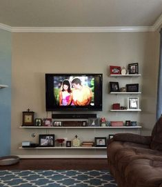 Floating shelves with mounted tv