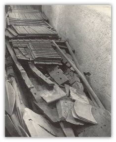 An early photograph of the Khufu ship's pieces as they sat in the burial pit prior to removal.