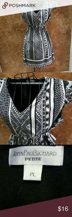 Pretty Dress! NWOT, black and white, ties at waist. Poly/spandex blend for flattering fit. John Paul Richard Dresses