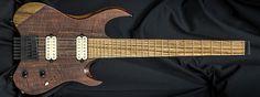 Carvin Guitars V7, figured claro walnut top (FW), black limba neck & body (NLMB), satin matte finish (CS), zebra wood fingerboard (ZWF), thicker neck profile (THKN), no inlays (NIN), gold jumbo frets (EVOJ), cream pickups (402), rosewood knobs (WK), Dunlop strap locks (SL), reverse gold drop shadow logo (50)