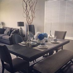 With a table setting this pretty, dinner must be a 💯 Shop @genna_ann's Strumfeld table and chairs in the link in our bio. #myashleyhome • • • • • #diningroom #dining #mycovetedhome #myhomevibe #styled #homedecor #homeinspo #decor #homegoals #currentdesignsituation #interiordesign #dream_interiors