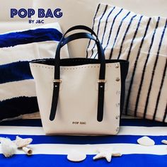 When we were children we were told that from a shell you could hear the sound of the sea. Common belief or sheer suggestion, what is certain is that sometimes just a perfume or a color combination takes us back to a moment at a sunny seaside resort, like the white and blue of our hammered leather MEDI #POPBAG BY J&C. Close your eyes and hear the sound of the waves. #POPBAG #JC #customizeyourbag #doityourself #navy