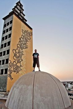 """El Seed is a French """"Calligraffiti"""" artist, who was born Tunisia in 1981. He grew up only knowing the Tunisian dialect, but quickly gained an interest in learning other languages."""