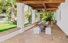 Al fresco dining. Lovely beamed porch at the Haciënda with rustic style dining table and chairs with linen covers. Ibiza country chic at its best...