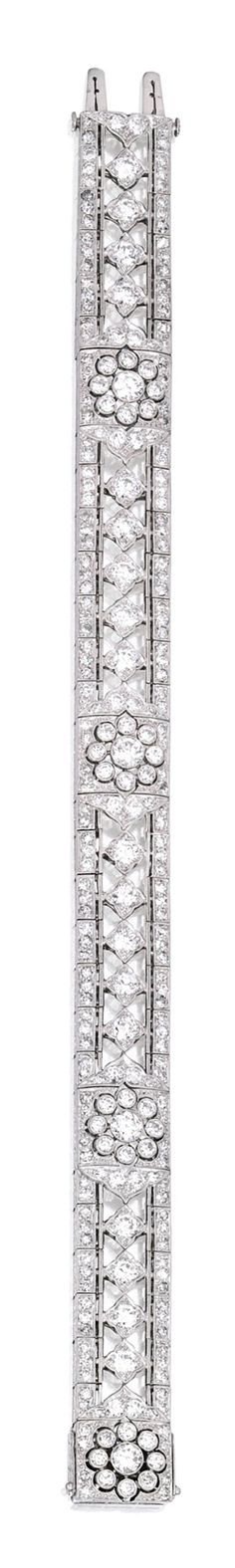 PLATINUM AND DIAMOND BRACELET Of openwork design decorated with floral motifs, set with numerous round and single-cut diamonds weighing approximately 8.55 carats, length 7½ inches.