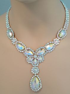 This beautiful necklace has lots of pear shaped crystals in various sizes to…