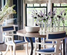 A few stems of pincushion flowers mixed with sprigs of lavender would make for a fairly wispy arrangement, but when you split them up into individual vases they make a showstopping tabletop moment.