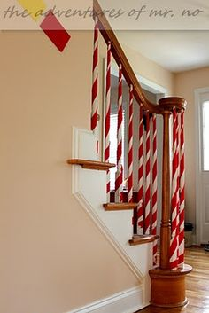 Wrap your staircase poles with white and red ribbon for a North Pole effect. Would be cute to have the elves do this