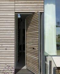 Timber clad pivot entry door