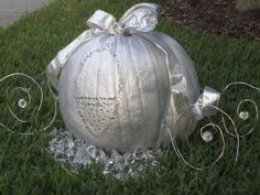 Cinderella Carriage centerpiece  (It should have the window carved and a candle inside it, before painting it silver.)