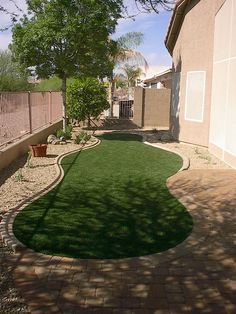 Brick outline with artificial grass center