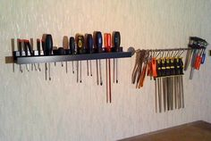 IKEA's RIBBA Picture Ledges tool rack to hold screwdrivers (next to it is a BYGEL rail)
