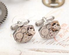 Extraordinary pair of steampunk style cufflinks.    Luxury mens accessories. Very masculine Swiss watches on Sterling silver cufflink bases. Their impression is worth more than thousand words.  Cufflinks features authentic Swiss watch movements They are slighty different, but I think it just make them even more astonishing. I decided to keep a windup in one of the watch works. These nice, tiny pink gems on them  are real rubies (jewel bearings).