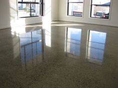 diamond-polished concrete, low-maintenance and very cost-effective over the lifetime of the floors. Add radiant heating.  This floor is all about ease of maintenance.  Something to consider for the build.
