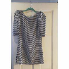 H&M Black and White Striped Mini Dress. Pretty short, not stretchy, runs small, but fits super cute. H&M Dresses Mini