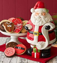 Collector's Edition Santa Cookie Jar from Cheryl's. www.teelieturner.com A delicious Holiday cookie assortment including this FAMOUS buttercream frosted cut-out cookies. The perfect addition to your own collection! #christmascookies