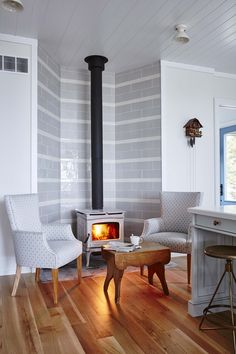 "Seating nook with a fireplace in an open kitchen designed by Sarah Richardson as seen on HGTV's ""Off the Grid."" Photo by Stacey Brandford (via HGTV)."