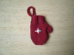 This is a decoration for my Advent Garland. It is knitted in the round and decorated with an embroidered star.