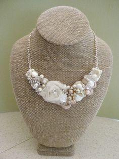 Blush Bridal Bib Necklace- Champagne Pink Wedding Statement Necklace- Rosette, Pearls, Lace, & Rhinestones. $75.00, via Etsy.