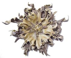 Bronze and pearly leather brooch