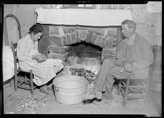 Mr. J. W. Melton and his wife by the fireplace getting ready for supper, October 1933. The U.S. National Archives via Flickr.