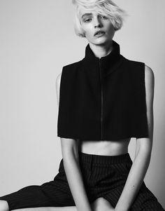 Sleek black crop top, bold minimalist fashion // COS