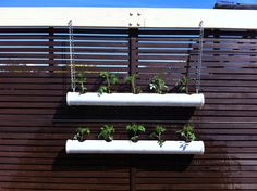 PVC pip that I drilled holes into, simply hung on a chain. I planted cherry tomatoes that way they can hang. :-)