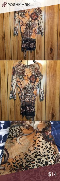 Woman's Fashion Tunic Woman's Unique Fashion Tunic. Leopard, chains, and other unique print design fabric. Tie string around waist. Great for spring and summer. Color multicolored. Size 18/20. Excellent Condition Ashley Stewart Tops Tunics