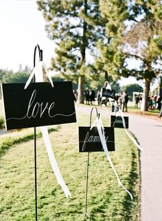 Black and white wedding signs for a formal wedding affair. Photo via Style Me Pretty