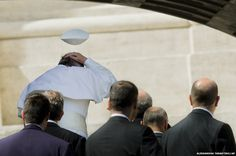 Pope Francis's skull cap is blown away in a gust of wind in St Peters Square