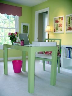Ann of Dwelling by Design created this dark pink and apple green floral home office.  Fresh and very Lilly Pullitzer.  A short bookcase behind the desk acts as a practical place to store books and folders, while the top is the perfect place for lighting and a surface for sorting papers.
