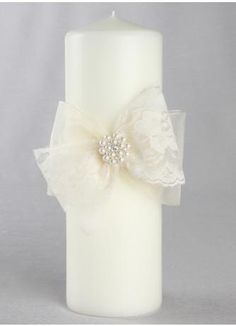 Intricate scalloped lace bows with a pretty pearl and rhinestone pin give this pillar candle an antique, yet whimsical feel. Available in white or ivory. Homemade Candles, Diy Candles, Pillar Candles, Wedding Unity Candles, Wedding Ceremony Flowers, Baptism Candle, Candle Craft, Flower Girl Basket, Christmas Candles